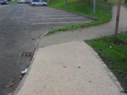 There is a cross gradient of 2.8% (1:35) for approximately 10m, the cross gradient increases to 3.5% (1:28) with a linear gradient of 6.4% (1:15) at the drop kerb and corner where the path coming from the car park joins the main path