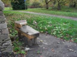 There is a seat at the start of the Arboretum Walk