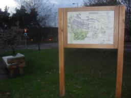 There is an information board with a map of the area and routes