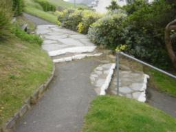 Clearly seen but uneven steps along path and on alternative path down to right.