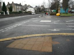 There are dropped kerbs and tactile paving at the road crossing at then Council entrance.