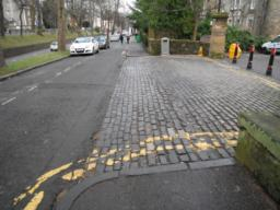 There are cobbles at the pedestrian side entrance to the Council where it joins the route.