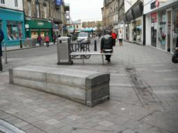 The pavement is wide and flat from the end of the pedestrianised area to the train station.
