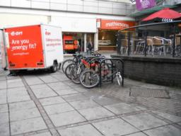 There is cycle parking available at a number of locations on route. This is outside the entrance to the Thistles shopping centre.