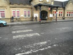 There is a zebra crossing to cross the taxi rank and dropping off point to access the train station.