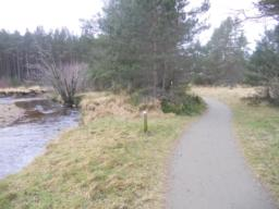 The path follows the stream down to Loch Morlich.
