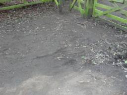 The surface of the car park deteriorates at the entrance to kissing gate and can be muddy after rainfall