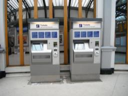 There are self serve ticket machines on the right as you exit the station.