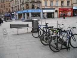 Cycle parking, litter bin and seating at the start of the pedestrianised area.