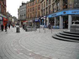 There are many seats in the pedestrianised area. It also offers high street shops, banks and ATMs as well as food outlets.
