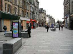 There are many seats in the pedestrianised area. It also offers high street shops, banks and ATMs as well as food outlets and a public telephone.