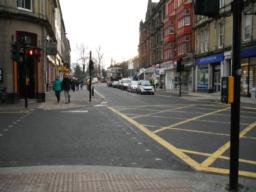 There is a controlled pedestrian crossing with dropped kerbs and tactile paving at the end of the pedestrianised area.