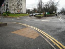 There are dropped kerbs and tactile paving at the junction to the Council entrance.