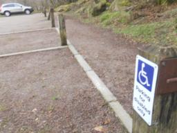 Three accessible parking areas are located in the car park.