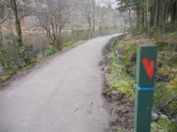 The path is level, wide and well compacted around Glencoe Lochan.