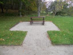 There were three picnic benches in the area surrounding the car park. One of the benches had a path to approach it and additional hard surfacing around the base to facilitate easier access.