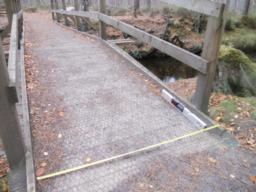 The path crosses the Black Burn bridge. A slight lip may cause difficulty for wheelchair users.