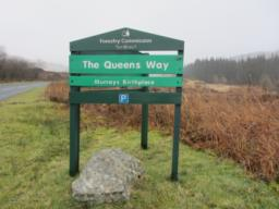 From New Galloway  take the A712 through the hills to Newton Stewart. The road passes Clatteringshaws Reservoir and goes through the Queen's Way to this sign, which marks the start of the trail.
