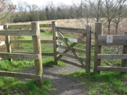 There is a kissing gate with a width of 90cm  on a gradient on a very short section up to 15.9% (1:6) and there is a