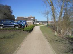 The path continues towards the Visitors Centre.