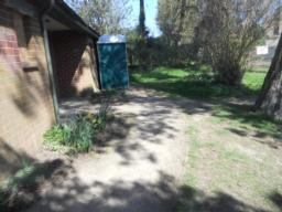 Accessible toilets are located about half way along the trail. These are accessed over a worn path.