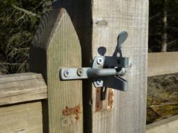 Latch on gate on side away from car park.