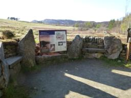 Seats and interpretation board at start of path.