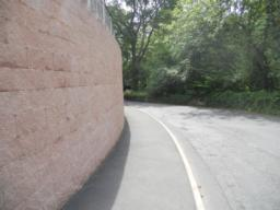 The gradient of the roadside path steepens.