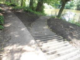 A path leads down to a dipping platform and fishing area. The boardwalk has been coated with anti-slip timber decking.
