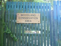The woodland conservation area is kept locked (although 'peep holes' have been provided). This marks the end of the trail.