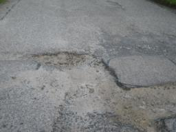 close-up of potholes, these can be avoided.