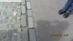 There are 2 different surfaces here - tarmac and cobbles.