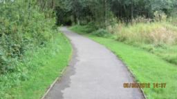 The path narrows to 1.5 metres. The verge is very wet and soggy.