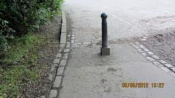 The bollard blocks the path.  80cm wide either side.