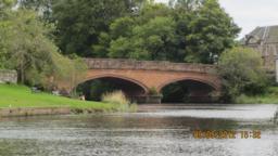 Walk back along the riverside towards the bridge.