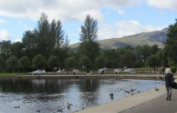 Turn right on tarmac path beside river. There are plenty of seats to sit on. There is a lovely view of Ben Ledi from here.