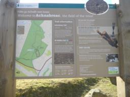 An information board at the site entrance displays the path network.