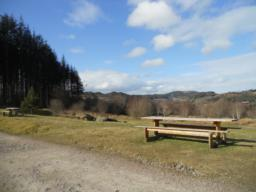 Three picnic benches are located in the car park area and are situated on level, unsurfaced ground.