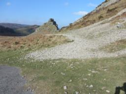A stony trail leads down the valley towards Castle Rock.