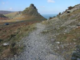 Continue down stony track to gap in the ridge.  Rocky ridge above you is dominated by
