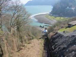 Small bridge crosses famous Lynton-Lymouth Cliff Railway.  Fine views over bay and up East Lyn River valley.