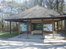 Toilet block with tourist information boards.
