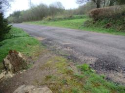 Proceed through the gateway and turn left onto a gravel road approx 4 metres wide. Proceed up the road approx 30 metres.