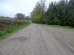 View along road looking towards the car park (approx 100 metres away) and slight downhill gradient.