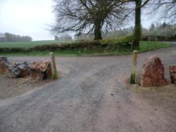 Exit through the car park entrance and turn left up a 4metre wide packed gravel lane