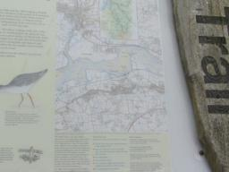 OS map on signpost giving location.