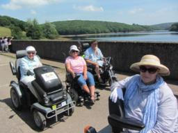 Mobility scooter group on top of Dam.