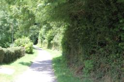 Continue forward onto the off road path running alongside the Hunters Inn grounds