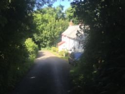 The attractive Upper Mannacott Cottage is passed on our right