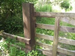 Simple catch to open gate. In wet weather the gate may need a slight lift to free the hook from the staple.